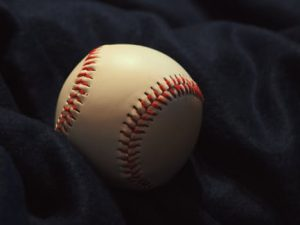 baseball-against-black-background